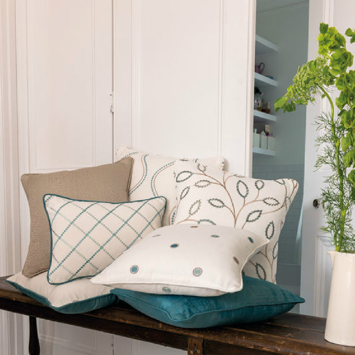 The Clarke and Clarke Atmosphere collection is a stylish collection of four embroidered patterns and two coordinating textured weaves in a modern, easy living style. Produced on a soft cotton group in popular shades of Teal, Berry, Heather and Natural. All fabric featured is from the Atmosphere collection and now available at Dean & Co.